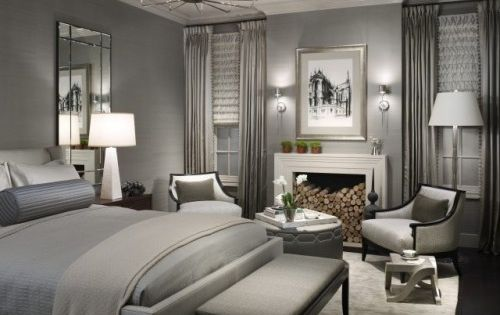 Grey Color Scheme in Contemporary Bedroom Design Ideas with Armchair and Fireplace