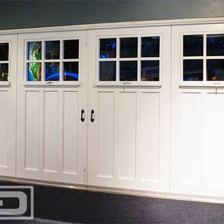 Garage Door To Carriage Door Conversion Project For A Garage Turned Playroom Eclectic Family Room Orange County Garage Doors Garage Room Carriage Doors