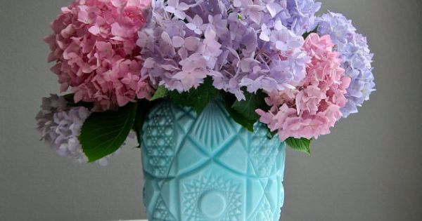 Pink and lilac floral arrangement in turquoise blue milk for Pink and blue flower arrangements