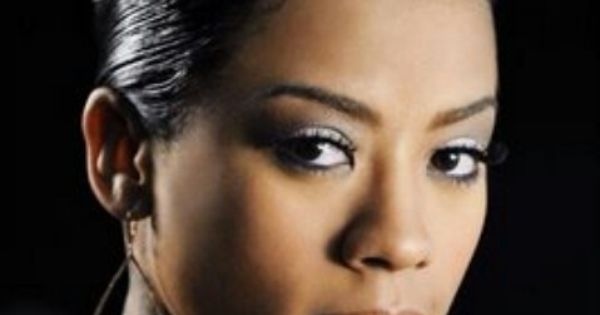 Keyshia Cole With A French Roll Hairstyle