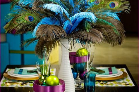 Love the use of peacock feathers in the centerpiece