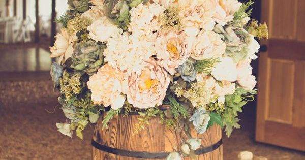 A favourite wedding idea of mine using wine barrels into weddings. Tiny