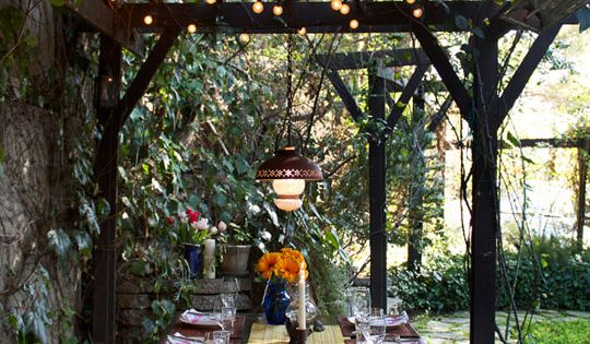 A picnic table sets the scene for a rustic garden dinner party