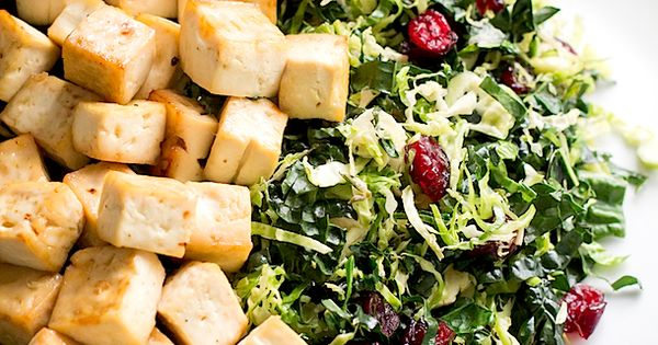 A shredded Warm Brussels Sprout and Kale Salad with Maple Glazed Tofu, perfect for Thanksgiving. This healthy side dish is vegan and gluten-free.