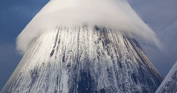 """A lenticular cloud above the Klyuchevskaya Sopka Mountain in Russia"" yes the"