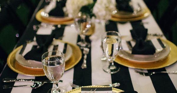 Black, white, & gold table setting for NYE