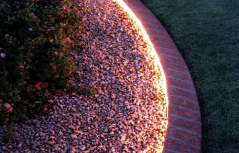 Rope lighting around the garden...inexpensive, waterproof- Define the edges of your walkways and garden paths.