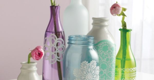 Put the perfect finishing touch on colored glass jars and bottles by embellishing them with delicate doilies and other lacy accents. Click for the DIY! | See more about Colored Glass, Glass Jars and Doilies.