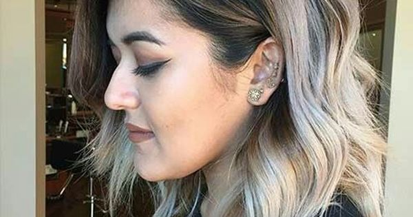 Love that ash blonde color with the dark roots and ...