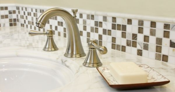 thin strip of glass tile as a bathroom vanity backsplash