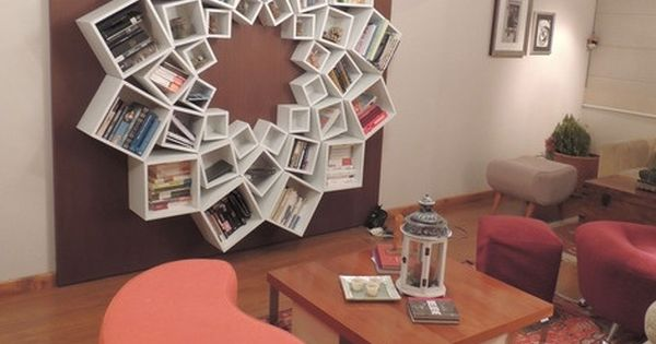 Wow! A book shelf out of square boxes arranged in a circle.