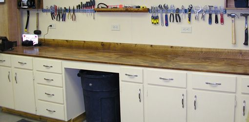 How To Upgrade Your Workbench With Old Cabinets Repurposed Kitchen Old Kitchen Cabinets Kitchen Cabinets In Garage