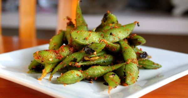 SPICY EDAMAME: 1 lb. edamame 2 1/2 T toasted sesame oil (or