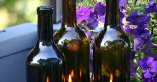 Wine bottles with pillar candles hint you cut the for How to remove bottom of glass bottle