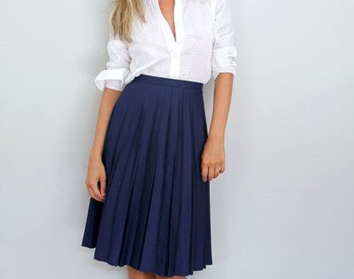 work outfit! White shirt, navy pleated skirt and brown wedges.