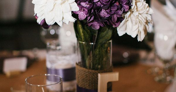purple and cream wedding centerpieces - table numbers in sparkle with diamonds
