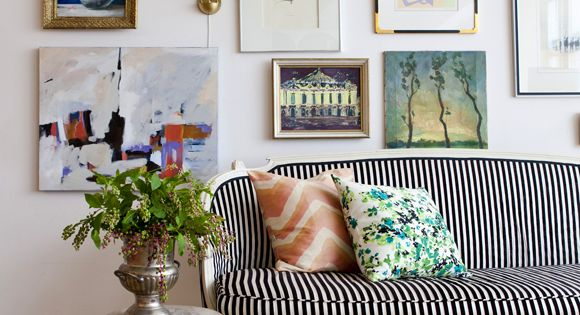 Art wall | gallery wall frames stripes sofa settee living room striped