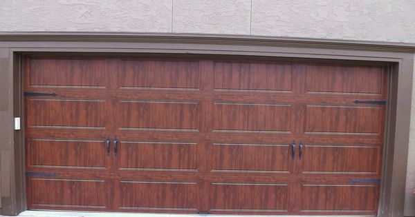 Clopay gallery garage door ultra grain walnut oak for Buy clopay garage doors online