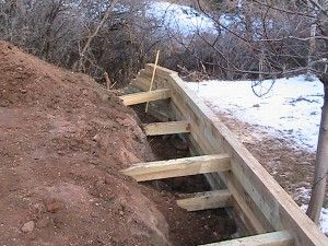 How To Build A Timber Retaining Wall Landscaping Retaining Walls Wood Retaining Wall Landscape Timbers