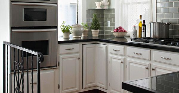 White cabinets and green subway tile with a crackle glaze transformed this