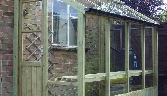 lean-to greenhouse. Beautiful small greenhouse. I wonder.... For side yard wasted space?