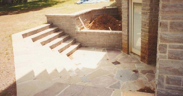 Lighting Basement Washroom Stairs: Basement Entrance Steps Leading Down To A Small Slat Patio