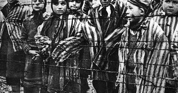 Children behind a barbed wire fence at the nazi