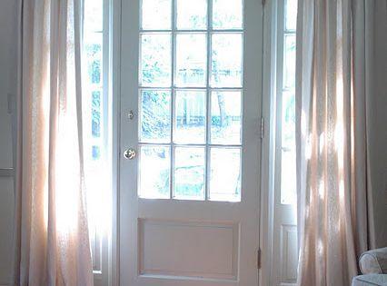 Curtain rod over front door