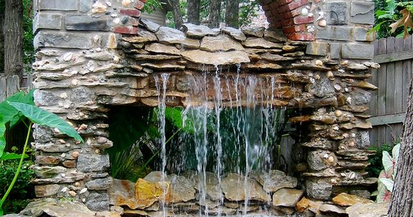 Outdoor Shower/Tub? Why not??!? :0) This combinations waterfall and pond serves as