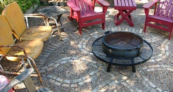 For an informal patio with some personality - gravel with inlaid brick