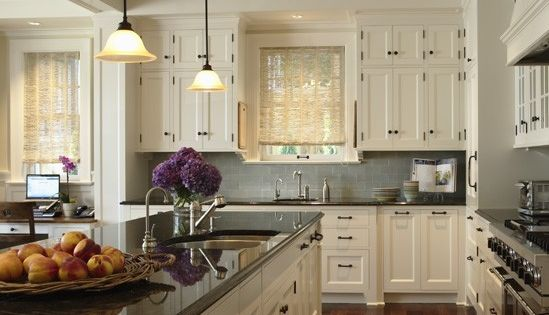 Alternate kitchen idea. Like the white cabinets and dark counters.