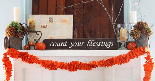 Fall Mantel with Hydrangeas and Ruffled Felt Garland. love the planked stove