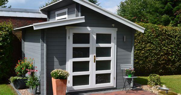 pultdach gartenhaus in grau und wei mit einer mediterran gestalteten terrasse urlaubsfeeling. Black Bedroom Furniture Sets. Home Design Ideas
