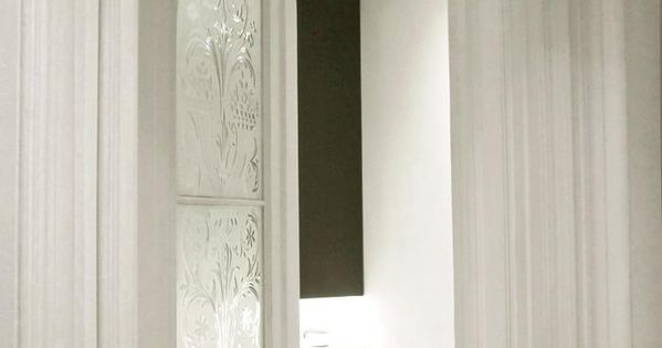 etched arched door for powder room