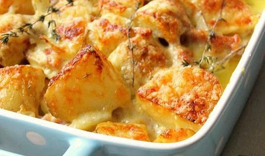 Tartiflette, a French comfort food. Lovely cheese melted on crispy potatoes, flavoured