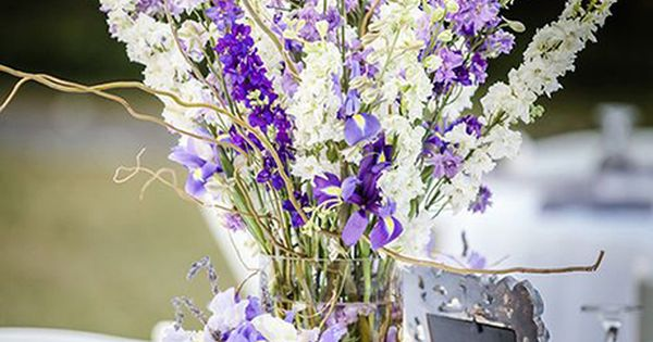 Brides purple and white centerpiece with larkspur flowers