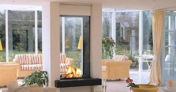 Double Sided Gas Fireplace With Tall See Through Panels Double Sided Fireplace Double Sided Gas Fireplace Living Room Seating Area