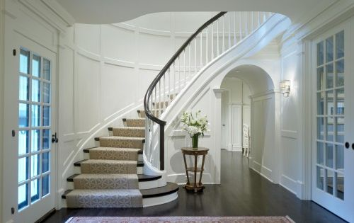 curved staircase and molding.