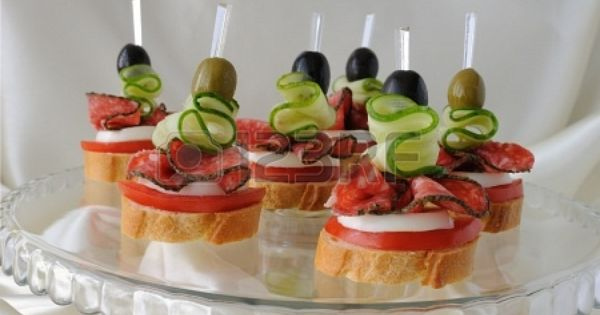 Canape of the baguette with salami on a glass base stock for Gluten free canape ideas