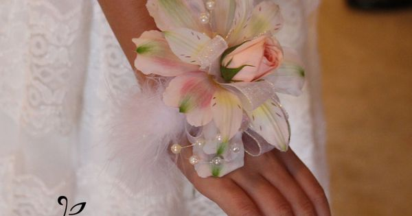 Feather Wrist Corsages For The Little Girls In The Wedding