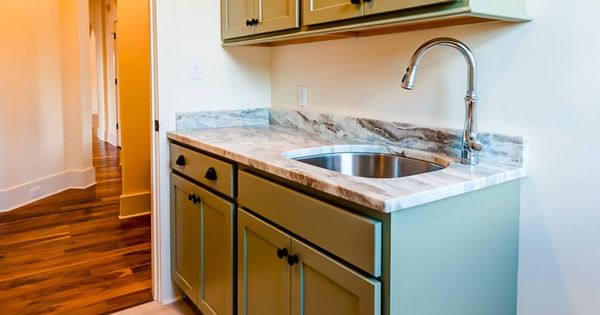 Laundry designed by angela raines at our gallery kitchen for Bathroom cabinets knoxville tn
