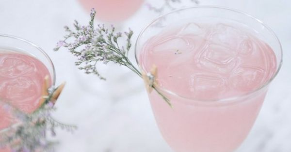 Rose Water Cointreau Fizz cocktails, with a little floral garnish.