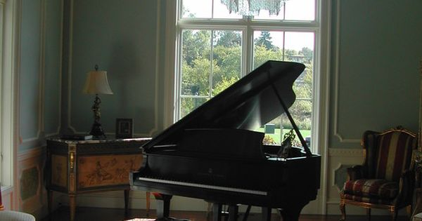 Beautiful family room decor with classic piano and tufted for Piano house classics