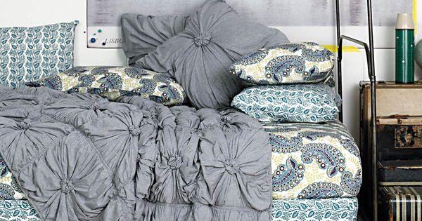 The grey bedspread looks so comfortable!