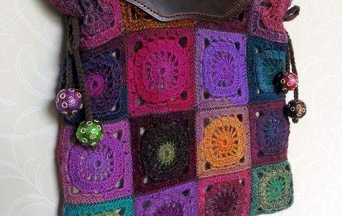 Flower-power crochet handbag with leather handles, and pom poms. So boho. fashion