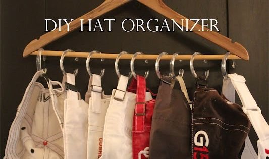 DIY Hat Organizer. Hanger and shower curtain c hooks. This looks like