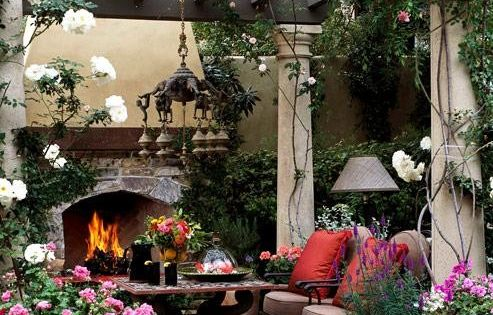 Outdoor living space. Love the columns holding up the pergola. Love the