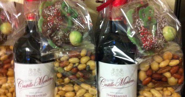 Fles wijn met nootjes en chocolade regalos especiales Artesania gallega regalos
