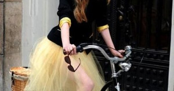 Looking pretty riding a bike in a pastel yellow tulle skirt.
