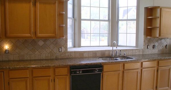 pic of kitchen backsplash brown granite counters with light wood cabinets rd 4169